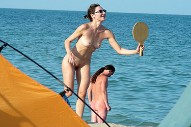 nude beach milf playing